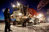 A worker from gas and oil exploration company Seismorazvedka guides an all-terrain 'Vibrator' vehicle in Russia's Arctic far north. The vehicle, made by French company Sercel, uses seismic vibration to test the structure of the earth crust to help prospect for oil and gas. /Felix Features