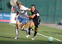 Lisa DeVanna #17 of Washington Freedom pushes away from Marian Dalmy #2 of Chicago Red Stars during a WPS match at RFK Stadium on June 13 2009, in Washington D.C.