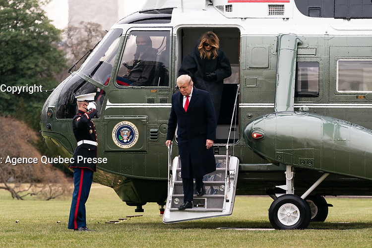 President Trump and the First Lady Return to the White House<br /> <br /> President Donald J. Trump and First Lady Melania Trump disembark Marine One on the South Lawn of the White House Thursday, Dec. 31, 2020, concluding their trip to Palm Beach, Fla. (Official White House Photo by Andrea Hanks)