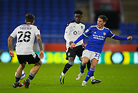 3rd November 2020; Cardiff City Stadium, Cardiff, Glamorgan, Wales; English Football League Championship Football, Cardiff City versus Barnsley; Harry Wilson of Cardiff City passes the ball while under pressure from Clarke Oduor and Dominik Frieser of Barnsley