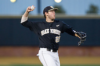 Wake Forest Demon Deacons third baseman Will Craig (22) makes a throw to first base against the Georgetown Hoyas at Wake Forest Baseball Park on February 16, 2014 in Winston-Salem, North Carolina.  The Demon Deacons defeated the Hoyas 3-2.  (Brian Westerholt/Four Seam Images)