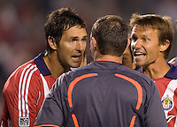 Chivas USA players Ante Razov (l) and Jesse Marsch (r) argue with Referee Terry Vaughn's red card call. The Houston Dynamo and Chivas USA played to a 1-1 tie at Home Depot Center stadium in Carson, California on Saturday October 25, 2008. Photo by Michael Janosz/isiphotos.com