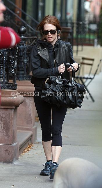 WWW.ACEPIXS.COM . . . . .  ....October 30 2009, New York City....Actress Julianne Moore walking around her West Village neighborhood on October 30 2009 in New York City....Please byline: PHILIP VAUGHAN - ACE PICTURES.... *** ***..Ace Pictures, Inc:  ..Philip Vaughan (212) 243-8787 or (646) 679 0430..e-mail: info@acepixs.com..web: http://www.acepixs.com
