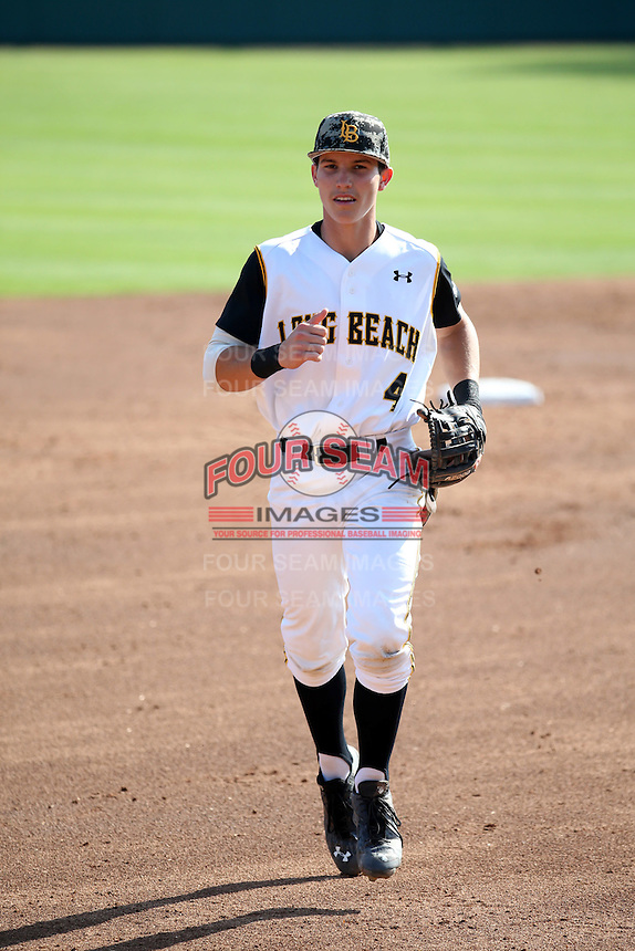 Jarren Duran (4) of the Long Beach State Dirtbags returns to the dugout during a game against the Arizona State Sun Devils at Blair Field on February 27, 2016 in Long Beach, California. Long Beach State defeated Arizona State, 5-2. (Larry Goren/Four Seam Images)