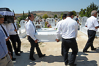 Pictured: Pallbearers carry the coffins of Sevasti Katife in Schisto, Piraeus, Greece. Friday 19 August 2016<br /> Re: The funeral for Theodosis Katifes and his five year old daughter Sevasti, two of the victims of a crash involving a speed boat and a ltourist boat has taken place at the Schisto area of Piraeus.<br /> Tharsivoulos Lykourezos, the captain of a speedboat that collided with a tourist boat off the Greek island of Aegina, killing four people, has appeared in court.<br /> The speedboat called Duente collided with a tourist boat called Antonia carrying more than 20 people.