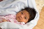 newborn baby girl one month old  Mexican American portrait closeup horizontal