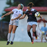 NWA Democrat-Gazette/ANDY SHUPE<br /> Arkansas' Jessi Hartzler (15) and Penn State's Frannie Crouse (9) leap to head the ball Friday, Aug. 25, 2017, during the Razorbacks' 4-2 loss at Razorback Field in Fayetteville. Visit nwadg.com/photos to see more photographs from the match.