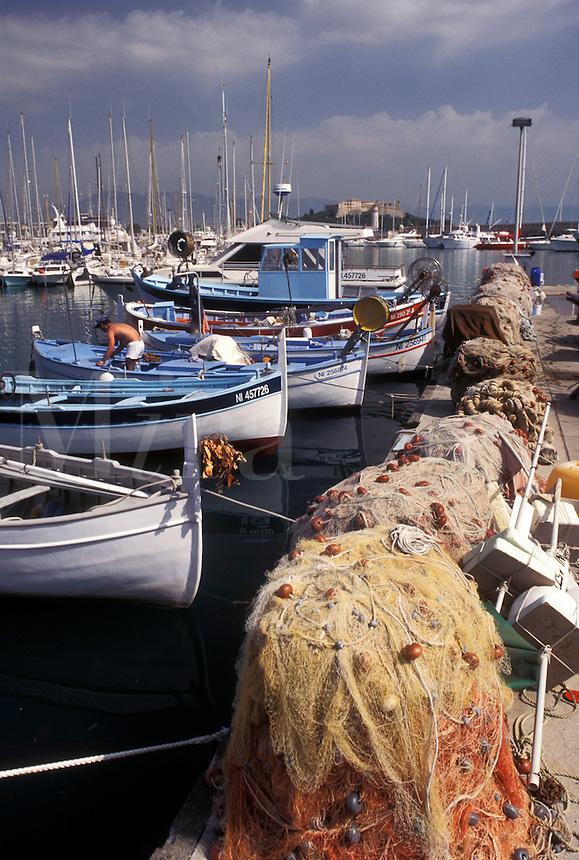 fishing boats, Antibes, Cote d' Azur, France, Provence, Alpes-Maritimes, Europe, Fishing boats docked in Port Vauban Harbor on the Mediterranean Sea in the city of Antibes. Fishing nets piled on the dock.