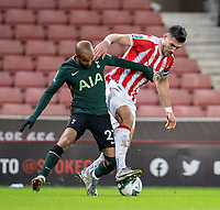 23rd December 2020; Bet365 Stadium, Stoke, Staffordshire, England; English Football League Cup Football, Carabao Cup, Stoke City versus Tottenham Hotspur; Lucas Moura of Tottenham Hotspur is held off by Danny Batth of Stoke City