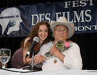 Montreal (Qc) Canada - August 24 2008 <br /> <br /> A fan give flowers to<br />  Tony Curtis and wife Jill-CAPTION UPDATE : Tony Curtis dies at 85 - Sept 2010 -