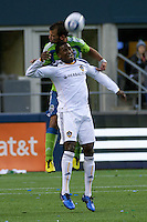 Patrick Ianni of the Seattle Sounders goes for a header against Los Angeles Galaxy defender Edson Buddle in the first game of the 2010 MLS Playoffs at the XBox 360 Pitch at Quest Field in Seattle, WA on October 31, 2010. The Galaxy defeated the Sounders 1-0.