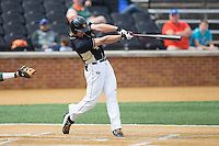 Stuart Fairchild (4) of the Wake Forest Demon Deacons connects on a solo home run to right field against the Miami Hurricanes at Wake Forest Baseball Park on March 22, 2015 in Winston-Salem, North Carolina.  The Demon Deacons defeated the Hurricanes 10-4.  (Brian Westerholt/Four Seam Images)