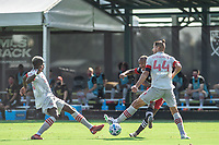 LAKE BUENA VISTA, FL - JULY 13: Ola Kamara #9 of DC United kicks the ball against Omar Gonzalez #44 of Toronto FC during a game between D.C. United and Toronto FC at Wide World of Sports on July 13, 2020 in Lake Buena Vista, Florida.
