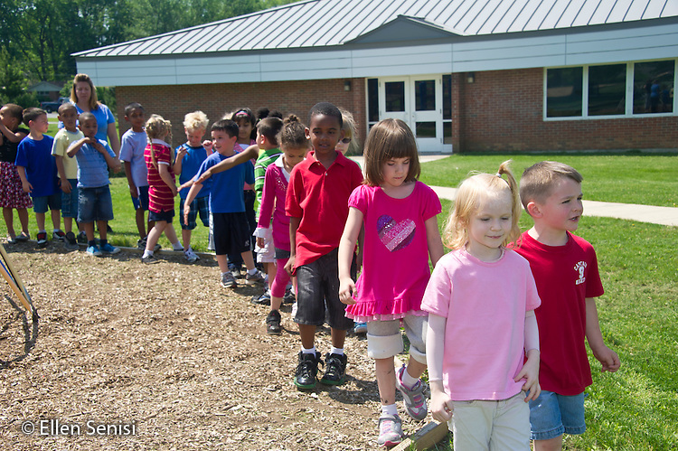MR / Schenectady, NY. Zoller Elementary School (urban public school). Kindergarten inclusion classroom. Diverse group of students line up in single file line after recess, ready to go inside. MR: AL-gKs. ID: AL-gKs. © Ellen B. Senisi.