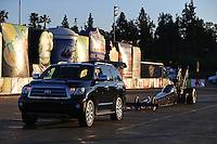 Feb 8, 2015; Pomona, CA, USA; Toyota tow vehicle tows NHRA top fuel driver Shawn Langdon back to the starting line after winning the Winternationals at Auto Club Raceway at Pomona. Mandatory Credit: Mark J. Rebilas-
