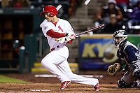 Thomas Pham #27 of the Springfield Cardinals follows through his swing during a game against the Corpus Christi Hooks at Hammons Field on April 11, 2013 in Springfield, Missouri. (David Welker/Four Seam Images)