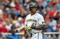 Michigan Wolverines designated hitter Jordan Nwogu (42) walks back to the dugout after striking out during Game 1 of the NCAA College World Series against the Texas Tech Red Raiders on June 15, 2019 at TD Ameritrade Park in Omaha, Nebraska. Michigan defeated Texas Tech 5-3. (Andrew Woolley/Four Seam Images)