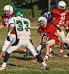 Football action. Runningback cuts away to daylight.