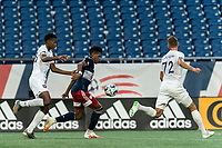 FOXBOROUGH, MA - AUGUST 7: Orlando Sinclair #99 of New England Revolution II attempts to control the ball as Thomas Williams #68 of Orlando City B pressures during a game between Orlando City B and New England Revolution II at Gillette Stadium on August 7, 2020 in Foxborough, Massachusetts.