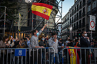 MADRID, SPAIN – MAY 04: A man waves the Spanish flag in front of the PP headquarters as a sign of victory on 4 May in Madrid, Spain. (Photo by Joan Amengual / VIEWpress via Getty Images)