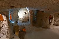 Massive round stone door in Kaymakli underground city, Cappadocia, Turkey