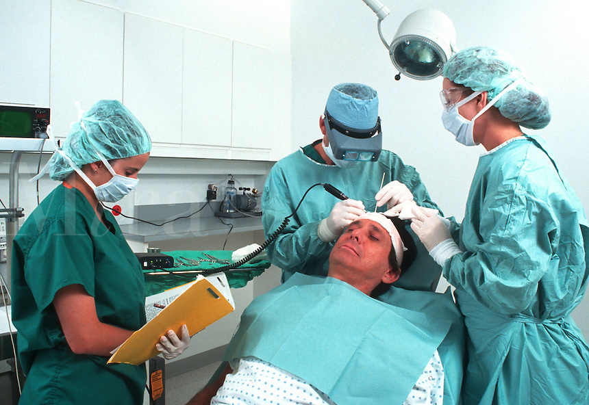 Medical specialist in operating room doing hair transplant