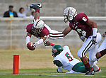 Alabama A&M defensive back Korey Morrison (34) goes airborne diving into end zone for touchdown after intercepting pass.  Alabama A&M vs. Mississippi Valley State football at Louis Crews Stadium Saturday afternoon.    Bob Gathany / The Huntsville TImes