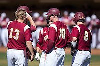 Winthrop Eagles head coach Tom Riginos (10) talks to Chad Smith (13) and Babe Thomas (8) during the game against the Kennesaw State Owls at the Winthrop Ballpark on March 15, 2015 in Rock Hill, South Carolina.  The Eagles defeated the Owls 11-4.  (Brian Westerholt/Four Seam Images)
