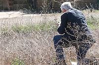 Brett Jones kneeling in a vineyard, taking a photo , Pajares de los Oteros spain castile and leon