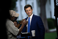 United States Secretary of Transportation Pete Buttigieg is prepared for a television interview at the White House in Washington, DC, October 13, 2021. Credit: Chris Kleponis / Pool via CNP /MediaPunch