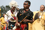 A Native American boy in traditional regalia dances in the dance circle at the 8th Annual Red Wing PowWow in Virginia Beach, Virginia.