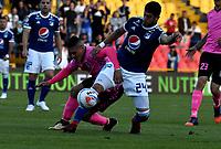 BOGOTÁ - COLOMBIA, 22-07-2018: Matías de los Santos (Der.) jugador de Millonarios disputa el balón con Diego Valdés (Izq.) jugador de Boyacá Chicó F. C., durante partido de la fecha 1 entre Millonarios y Boyacá Chicó F. C., por la Liga Aguila II-2018, jugado en el estadio Nemesio Camacho El Campin de la ciudad de Bogota. / Matias de los Santos (R) player of Millonarios vies for the ball with Diego Valdes (L) player of Boyaca Chico F. C., during a match of the 1st date between Millonarios and Boyaca Chico F. C., for the Liga Aguila II-2018 played at the Nemesio Camacho El Campin Stadium in Bogota city, Photo: VizzorImage / Luis Ramirez / Staff.