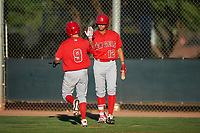 AZL Angels Spencer Brown (9) is congratulated by Jose Reyes (12) after scoring a run during an Arizona League game against the AZL D-backs on July 20, 2019 at Salt River Fields at Talking Stick in Scottsdale, Arizona. The AZL Angels defeated the AZL D-backs 11-4. (Zachary Lucy/Four Seam Images)