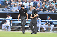 Umpires Willie Traynor and Adam Pierce during a game between the Winston-Salem Dash and the Asheville Tourists on August 6, 2021 at McCormick Field in Asheville, NC. (Tony Farlow/Four Seam Images)