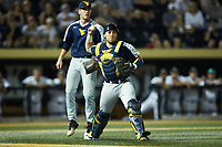 West Virginia Mountaineers relief pitcher Sam Kessler (42) is greeted by teammates after being taken out of the game against the Wake Forest Demon Deacons in Game Four of the Winston-Salem Regional in the 2017 College World Series at David F. Couch Ballpark on June 3, 2017 in Winston-Salem, North Carolina. The Demon Deacons walked-off the Mountaineers 4-3. (Brian Westerholt/Four Seam Images)