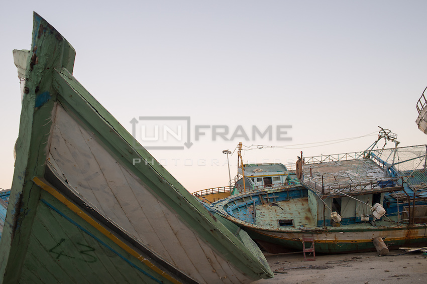 Wreckages of fishing boats used by human traffickers are piled up in an area of the Sicilian port of Pozzallo. Every week new wreckages are added here to the pile by the port authority, following each rescue mission by the Italian coast guard in the strait of Sicily, Mediterranean sea. The Mare Nostrum operation has been replaced by Frontex operation Triton on Nov. 2014 with consistent critics, highlighted by the recent shipwreck of Apr. 19, 2015 in which more than 850 refugees have drowned. Pozzallo, Italy. Apr. 05, 2015