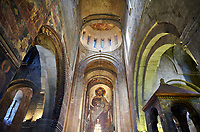 Pictures & images of the interior main aisle and apse fresco depicting Christ Pantocrator. The Eastern Orthodox Georgian Svetitskhoveli Cathedral (Cathedral of the Living Pillar) , Mtskheta, Georgia (country). A UNESCO World Heritage Site.<br /> <br /> Currently the second largest church building in Georgia, Svetitskhoveli Cathedral is a masterpiece of Early Medieval architecture completed in 1029 by Georgian architect Arsukisdze on an earlier site dating back toi the 4th century.