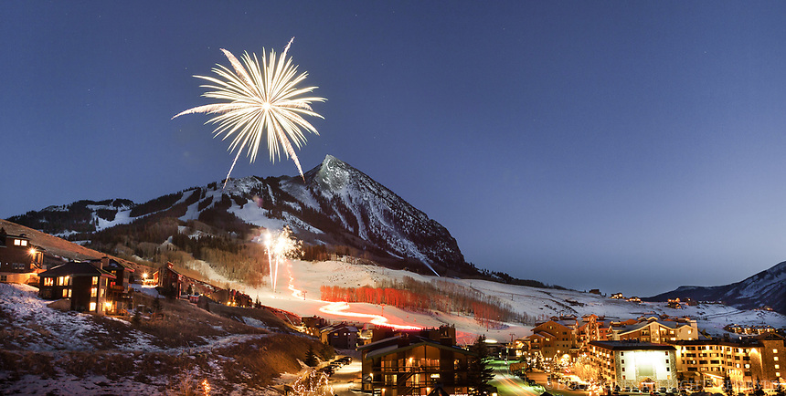 Fireworks begin as the Torchlight Parade finishes at the base of Mt Crested Butte.  A magical scene!