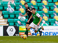 21st April 2021; Easter Road, Edinburgh, Scotland; Scottish Premiership Football, Hibernian versus Livingston; Joe Newell of Hibernian chases down a short back pass from Jon Guthrie of Livingston