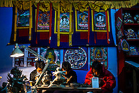 Local Bhutanese Craftsmen work in a handicrafts store in the capital Thimpu.