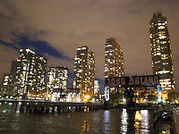USA. New York City. Long Island City. Night view from Gantry Plaza State Park, a 12-acre riverside oasis that boasts spectacular views on four piers and the rugged beauty of the park's centerpieces - restored gantries. These industrial monuments were once used to load and unload rail car floats and barges; today they are striking reminders of the waterfront's past. Hudson river. 22.10.2011 © 2011 Didier Ruef