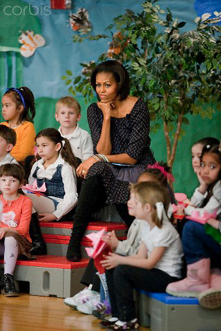 03 Mar 2011, Washington, DC, USA --- First Lady Michelle Obama reads 'The Cat in the Hat' to students during a visit to the Oyster Adams Bilingual School in Washington --- Image by © Brooks Kraft/Corbis