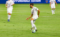 CARSON, CA - OCTOBER 07: Emiliano Insua #3 of the Los Angeles Galaxy moves with the ball during a game between Portland Timbers and Los Angeles Galaxy at Dignity Heath Sports Park on October 07, 2020 in Carson, California.