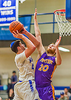 22 November 2015: Yeshiva University Maccabee Forward Shelby Rosenberg, a Senior from Woodmere, NY, is defended by Hunter College Hawk Forward Matt Franks, a Sophomore from Mamaroneck, NY, as Rosenberg lays one up in NCAA Men's Basketball play at the Max Stern Athletic Center  in New York, NY. The Maccabees defeated the Hawks 81-71 in non-conference play, for their second win of the season. Mandatory Credit: Ed Wolfstein Photo *** RAW (NEF) Image File Available ***