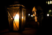 Close up view of a lantern and a skull on a ghost tour of Charleston, SC.