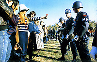 Anti-Vietnam demonstrator offers a flower to a miltary police, Arlington, Virginia, October 21, 1967. By S. Sgt. Albert Simpson.<br /> <br /> Credit: National Archives and Records Administration
