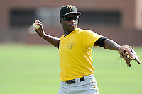 Left fielder Candon Myles (16) of the Bristol Pirates warms up before a game against the Greeneville Astros on Friday, July 25, 2014, at Pioneer Park in Greeneville, Tennessee. Greeneville won, 9-4. (Tom Priddy/Four Seam Images)