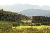 Gated stone wall and the Nantlle Ridge in the Snowdonia National Park in North Wales