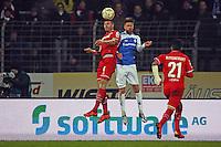 Jonas Hector (Koeln) klaert gegen Tobias Kempe (Darmstadt) - SV Darmstadt 98 vs. 1. FC Koeln, Stadion am Boellenfalltor