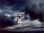 Optomistic eye looking through keyhole in storm clouds